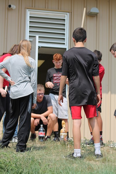 HMS students working on a science experiment outside